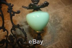 Candlestick metal & green opaline glass candlestick green glass urns antique